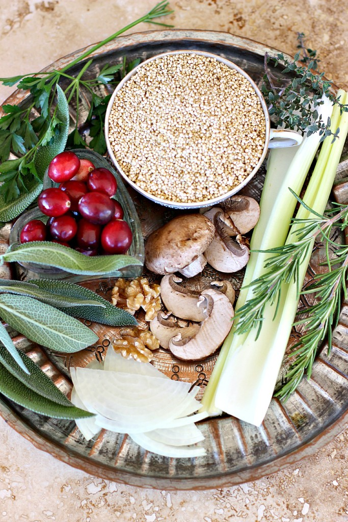 Thanksgiving Quinoa ingredients of quinoa, fresh savory herbs, parsley, sage, rosemary and thyme, onions, celery, walnuts, mushrooms and cranberries