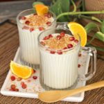 White chocolate coconut mousse with toasted coconut and pomegranate seeds