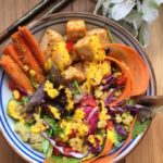 quinoa salad bowl with carrot ginger sauce