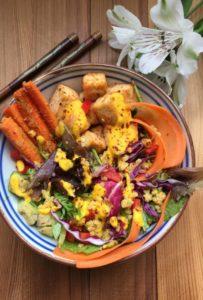 quinoa salad bowl with carrot ginger sauce