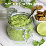 Pinterest graphic of a jar of avocado cilantro pesto and a half of lime a small bowl of crackers