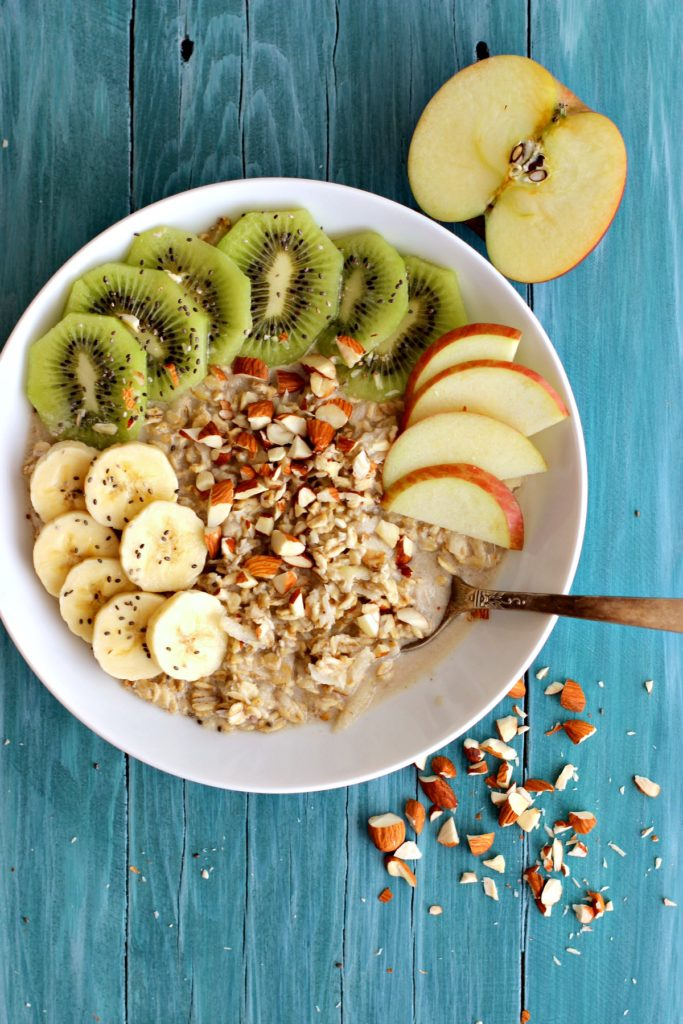 Bowl of Healthy Apple Almond Overnight Oats with fresh fruit and chopped almonds