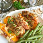 Creamy Tahini Gravy topped baked sweet potatoes