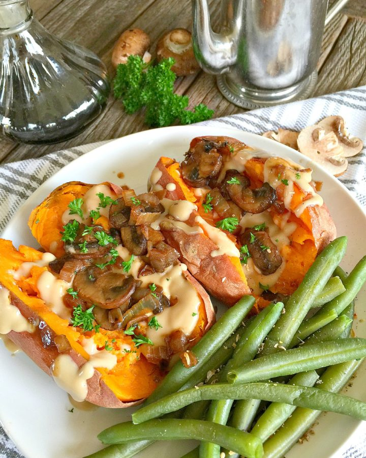 Creamy Tahini Gravy topped baked sweet potatoes