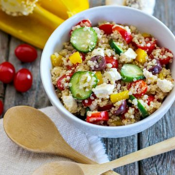bowl of quinoa salad with feta and colorful veggies