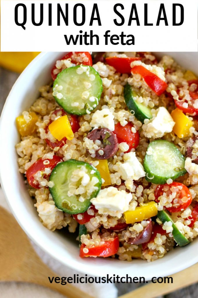 bowl of colorful veggie filled quinoa salad with feta cheese