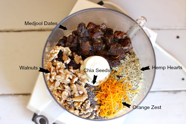 Food processor with chopped dates, walnuts, chia seeds, hemp hearts and orange zest.