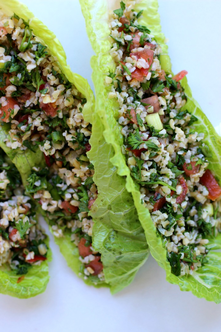 image of tabouli salad recipe added to romaine lettuce leaves