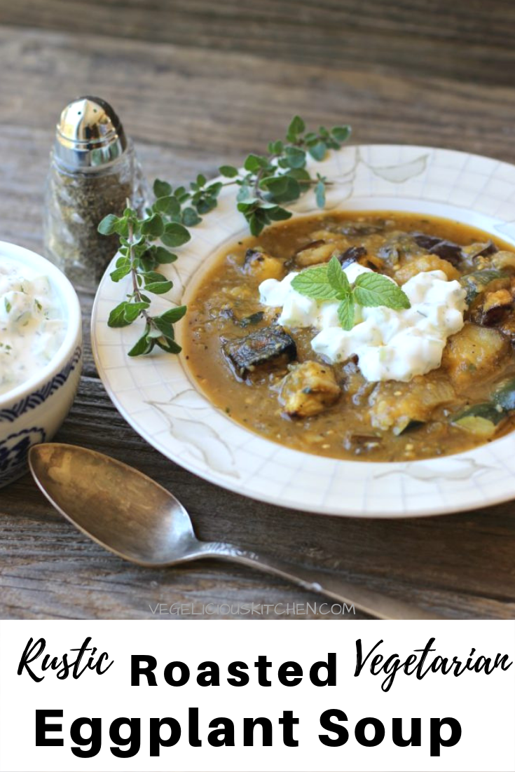 White bowl with Eggplant Soup and topped with Tzatziki on a rustic wooden surface
