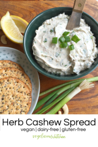 Pinterest graphic of green bowl with white herb cashew spread topped with green onions on a wooden surface