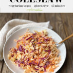 Pinterest graphic of a white bowl of coleslaw on a rustic wooden surface
